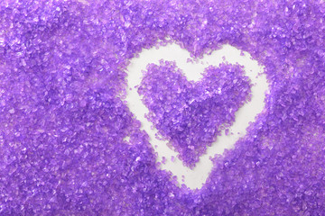 Background with lilac bath salts and heart top view