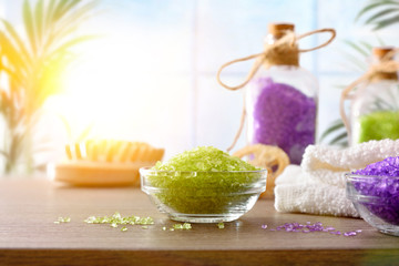 Skin care products on white table and window background