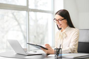 Female accountant working in office Fotobehang