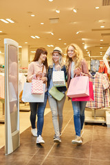 Young women as friends while shopping