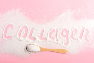 Scattered collagen on a pink background close-up.