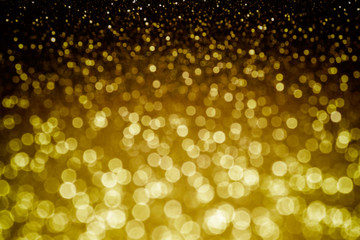 Golden glittering background. Sparkle glitter texture with the bokeh and the lights, shiny metal...
