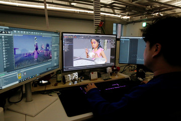 An employee works on a virtual reality animation at the office of Vive Studios in Seoul