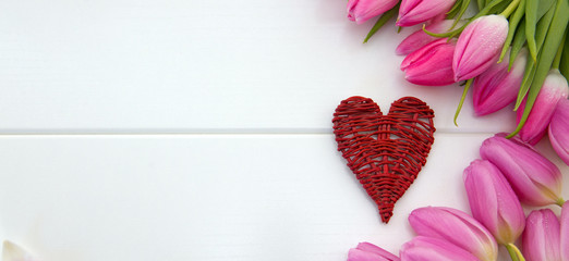 Pink tulips decoration and heart on white .Valentine's Day background.