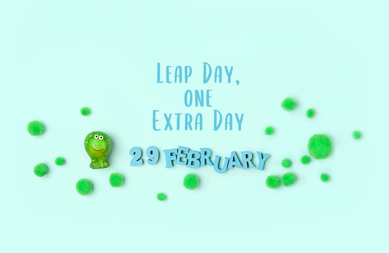 February 29 date, Leap day, one extra day. cute Frog on green background. leap day in leap year concept.