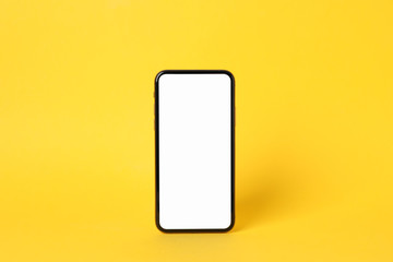 Phone with empty on yellow background, space for text