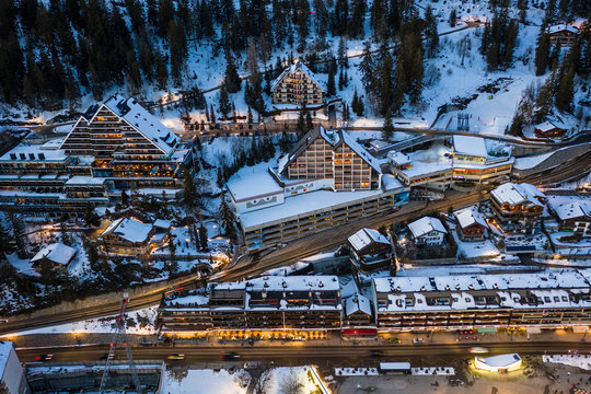 Aerial view of Crans-Montana village center with many like chalet style hotel and residence in Valais, Switzerland