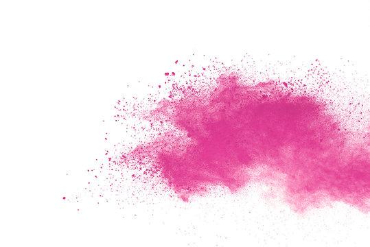 Pink powder explosion on white background. Paint Holi.