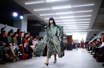 A model presents a creation during the Matty Bovan catwalk show at London Fashion Week in London