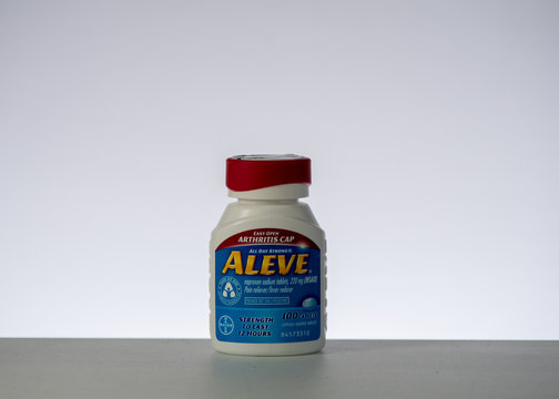 Bottle of Aleve against white background, side view