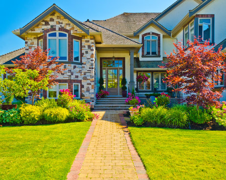 Entrance of a house with nice outdoor landscape over blue sky