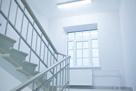 A white stairs up ladder in a new office building