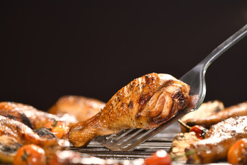 Wall Mural - Grilled chicken leg with various vegetables on the grill