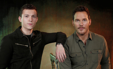 """Cast members Holland and Pratt pose for a portrait while promoting the film """"Onward"""" in Los Angeles"""