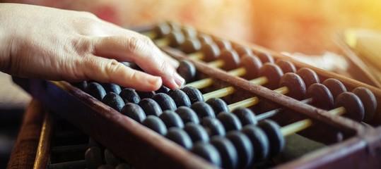 hands of woman choosing  abacus