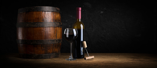 Stores à enrouleur Alcool Expensive wine bottles collection and wooden barrel in the cellar, wine tasting and production concept
