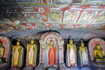 Buddha statue inside Dambulla cave temple on February 8, 2020 in Dambulla, Sri Lanka. Cave II Maharaja Viharaya. Major attractions are spread over 5 caves, which contain statues and paintings.