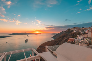 Wall Murals Santorini Amazing evening view of Santorini island. Picturesque spring sunset on the famous Greek resort Fira, Greece, Europe. Traveling concept background. Artistic style post processed photo. Summer vacation