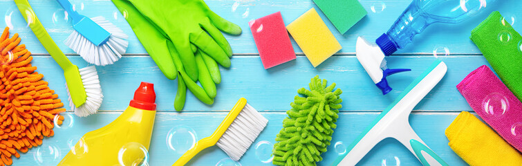 Colorfull cleaning items on blue wooden