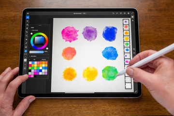 BATH, UK - FEBRUARY 15, 2020: Adobe Fresco application being used to create a digital watercolour painting on an Apple iPad Pro.