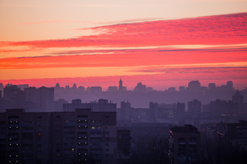 Sunset in Kiev, evening view of the panorama Kiev city. Red clouds in the capital of Ukraine