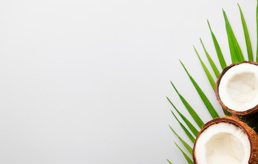 Coconut and pieces of coconut on gray background, top view, copy space Wall mural