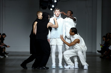 Models present creations by designer Saul Nash at the Fashion East catwalk show during London Fashion Week in London