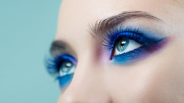 Glamorous bright eye makeup using the trend color classic blue, women's eyes close-up.