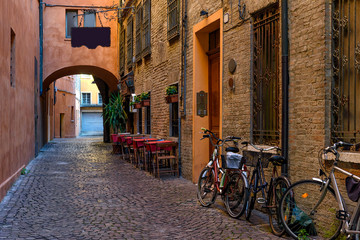 Wall Mural - Cozy narrow street in Ferrara, Emilia-Romagna, Italy. Ferrara is capital of the Province of Ferrara