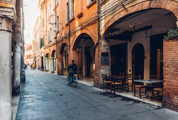 Fotomurales - Cozy narrow street in Ferrara, Emilia-Romagna, Italy. Ferrara is capital of the Province of Ferrara