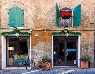 Wall Mural - Cozy narrow street in Ferrara, Emilia-Romagna, Italy. Ferrara is capital of the Province of Ferrara