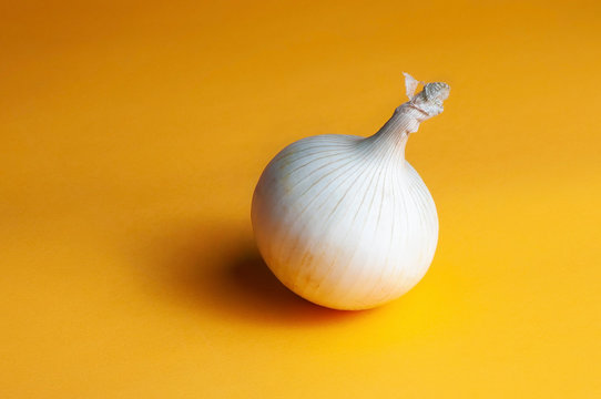 White onions on a yellow background.Close-up shooting.