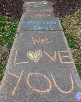 Valentine's Day message on sidewalk leading to family house.