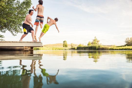 Young adults having fun in a swimming lake. Bridger, Montana, USA