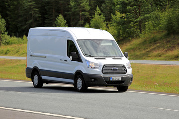 White Ford Transit Van on Motorway. Illustrative Editorial Content.