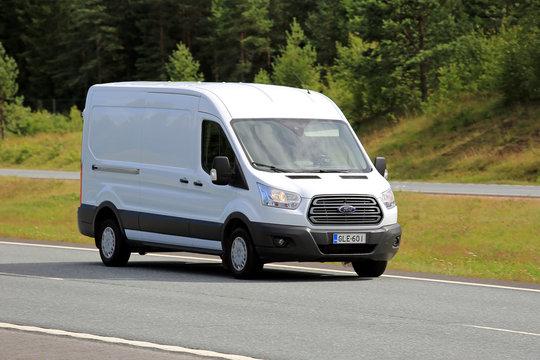 White Ford Transit Van on Motorway. Illustrative Editorial Content.
