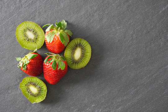 A group of kiwi and strawberries viewed from above
