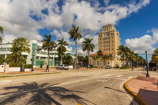 Landscape view of street of Miami. Colorful buildings on blue sky with white clouds background.  USA. Miami South Beach