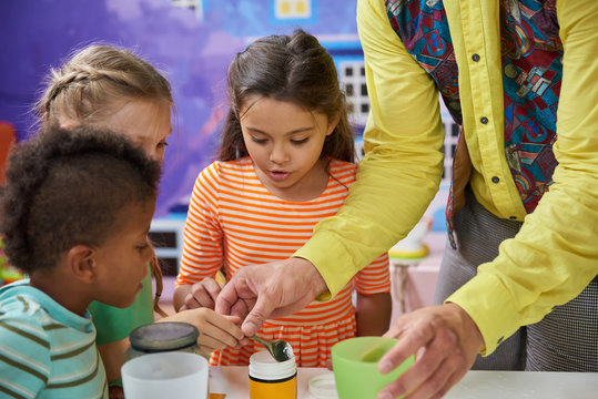 Kids doing a chemical experiment in playroom. Kids having fun at childrens entertainment center. Easy science experiments for kids.
