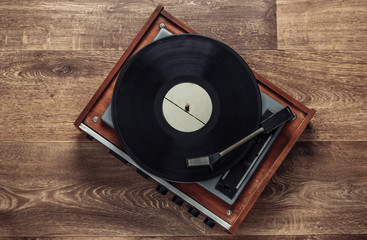 Obraz Retro vinyl record player with a record on the floor. 80s. Top view - fototapety do salonu