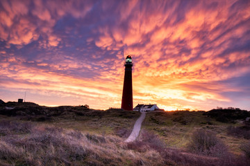 dramatic purple mammatus clouds over lighthouse