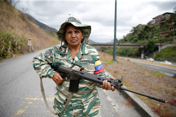 A member of the Bolivarian Militia poses for a picture during a military exercise in Caracas