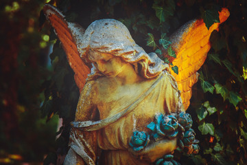 Fototapete - Guardian angel. Ancient statue in the light.