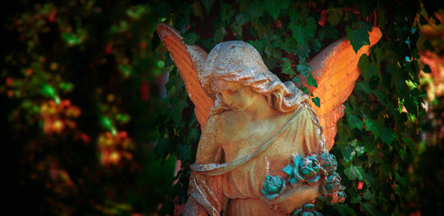 Wall Mural - Beautiful sad angel. Vintage styled image of ancient statue.