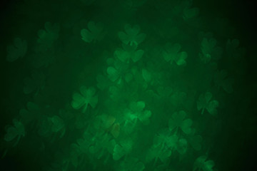 Clover shaped bokeh. St.Patrick 's Day. Blurred abstract background. Green shamrock
