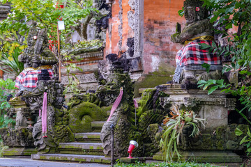 Fotobehang Bedehuis Balinese sculptures and traditional architectural details in a temple near Ubud, Bali, Indonesia
