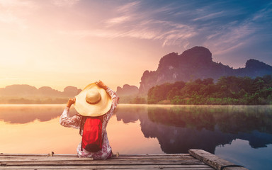 Traveler woman joy looking beautiful sunrise view reflection nature mountain landscape on lake, Lifestyle adventure travel Krabi Phuket Thailand, Tourism destination Asia, Summer holiday vacation trip Fotobehang
