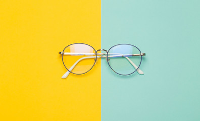 Eye glasses isolated on yellow and blue background.
