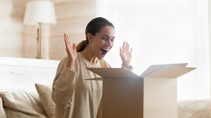 Overjoyed female customer happy with internet delivery order