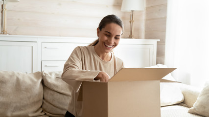 Happy young woman satisfied with internet shopping order